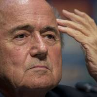 Photo - FIFA President Sepp Blatter looks on during a press conference where he talked about the organization and infrastructure of the upcoming World Cup, in Sao Paulo, Brazil, Thursday, June 5, 2014. The World Cup soccer tournament starts on 12 June. (AP Photo/Andre Penner)