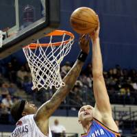 Photo - Thunder center Cole Aldrich (45) dunks over Bobcats forward Tyrus Thomas. AP photo