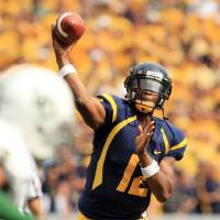 Photo -   West Virginia quarterback Geno Smith (12) throws during their NCAA college football game against Baylor in Morgantown, W.Va., Saturday, Sept. 29, 2012. Smith threw for 8 touchdowns with 656-yards. (AP Photo/Christopher Jackson)