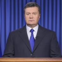 Photo - File- This Feb. 19, 2014, file photo shows Ukrainian President Viktor Yanukovych addressing the nation on a live TV broadcast in Kiev, Ukraine. The fugitive president said in a statement published by three Russian news agencies that he is asking Russia's protection from