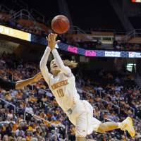 Photo - Tennessee guard Meighan Simmons (10) is fouled as she shoots in the first half of an NCAA college basketball game against Florida Thursday, Jan. 23, 2014, in Knoxville, Tenn. (AP Photo/Wade Payne)