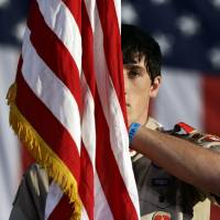 Photo -   Boy Scout Nicholas Reade, 17, from Reynoldsburg, Ohio, stands during the trooping of the colors before Republican presidential candidate and former Massachusetts Gov. Mitt Romney and Republican vice presidential candidate, Rep. Paul Ryan, R-Wis., speak at a campaign event in Lancaster, Ohio, Friday, Oct. 12, 2012. (AP Photo/Charles Dharapak)