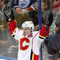 Photo - Calgary Flames' Curtis Glencross (20) celebrate a goal against the Edmonton Oilers during the second period of an NHL hockey game Saturday, March 22, 2014, in Edmonton, Alberta. (AP Photo/The Canadian Press, Jason Franson)