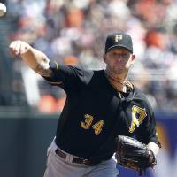 Photo - Pittsburgh Pirates starting pitcher A.J. Burnett throws against the San Francisco Giants in the first inning of a baseball game in San Francisco, Sunday, Aug. 25, 2013. (AP Photo/Tony Avelar)