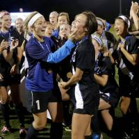 Photo - Deer Creek celebrates with the trophy after winning the Class 5A girls state soccer championship between Deer Creek and Carl Albert in Norman, Okla., Saturday, May 17, 2014. Photo by Bryan Terry, The Oklahoman