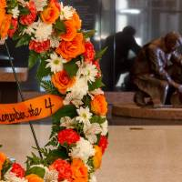Photo - A wreath stands in the lobby in front of the
