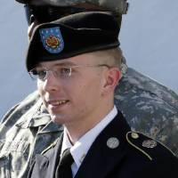 Photo - FILE - In this June 25, 2012 file photo, Army Pfc. Bradley Manning is escorted out of a courthouse in Fort Meade, Md., after a pre-trial hearing. Government secrecy in the court-martial of Manning, who gave reams of classified documents to WikiLeaks, reaches a new level this week. The military judge has ordered an apparently unprecedented closed hearing Wednesday, May 8, 2013 to help her decide how much of Manning's trial will be closed to protect national security. (AP Photo/Patrick Semansky, File)