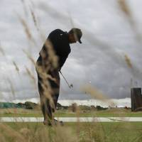 Photo - Tiger Woods of the US plays a shot off the 9th tee during a practice round ahead of the British Open Golf championship at the Royal Liverpool golf club, Hoylake, England, Tuesday July 15, 2014. The British Open starts on Thursday July 17. (AP Photo/Peter Morrison)