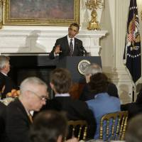 Photo - President Barack Obama addresses the National Governors Association, Monday, Feb. 25, 2013, in the State Dining Room of the White House in Washington. (AP Photo/Charles Dharapak)