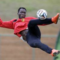 Photo - Romelu Lukaku kicks the ball during a training session of Belgium in Mogi Das Cruzes, Brazil, Thursday, June 19, 2014. Belgium play in group H of the 2014 soccer World Cup. (AP Photo/Andrew Medichini)