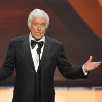 """Photo - FILE - This Jan. 27, 2013 file photo shows Dick Van Dyke on stage at the 19th Annual Screen Actors Guild Awards at the Shrine Auditorium in Los Angeles. Van Dyke is undergoing tests for """"cranial throbbing"""" that's causing him to lose sleep. Spokesman Bob Palmer said Thursday the 87-year-old Van Dyke has been experiencing a throbbing sensation in his head when lying down. Scans and other tests have yet to yield a diagnosis, Palmer said. (Photo by John Shearer/Invision/AP, file)"""