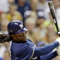 Photo -   Milwaukee Brewers' Rickie Weeks hits a three-run home run during the fifth inning of a baseball game against the Atlanta Braves, Wednesday, Sept. 12, 2012, in Milwaukee. (AP Photo/Morry Gash)
