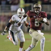 Photo - FILE - In this Nov. 2, 2013, file photo, Florida State quarterback Jameis Winston (5) outruns Miami defensive lineman Anthony Chickillo (71) during the first quarter of an NCAA college football game, in Tallahassee, Fla.  (AP Photo/Chris O'Meara, File)