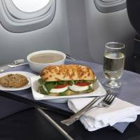 Photo - This product image provided by United Airlines shows a Caprese on Asiago Baguette sandwich, one of a variety of the airline's new first class food options.  The Chicago-based airline on Thursday, Aug. 21, 2014 announced that it's upgrading first class food options and replacing snacks with full meals on some of its shortest flights. (AP Photo/United Airlines)