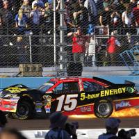 Photo -   Clint Boyer (15) stops along the front straightaway after being hit by Jeff Gordon during a NASCAR Sprint Cup Series auto race, Sunday, Nov. 11, 2012, at Phoenix International Raceway in Avondale, Ariz. (AP Photo/Matt York)