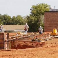 Photo - Construction takes place behind Del City Elementary in Del City. PHOTO BY PAUL B. SOUTHERLAND, THE OKLAHOMAN  PAUL B. SOUTHERLAND - THE OKLAHOMAN