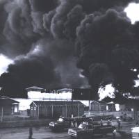 Photo -  In this July 1973 photo provided by the Oklahoma Department of Corrections, a fire burns inside the gate at the Oklahoma State Penitentiary at McAlester in McAlester, Okla., during one of the most destructive prison riots in American history. The prison erupted into violence on July 27, 1973, the result of overcrowding, inadequate supervision, poor health care and a culture of violence within the prison walls. The prison was eventually rebuilt as a maximum security prison. (AP Photo/Oklahoma Department of Corrections) ORG XMIT: OKSO213