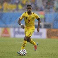 Photo - Cameroon's Samuel Eto'o runs with the ball during the group A World Cup soccer match between Mexico and Cameroon in the Arena das Dunas in Natal, Brazil, Friday, June 13, 2014.  (AP Photo/Ricardo Mazalan)