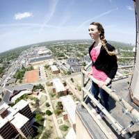 Photo - Oklahoman reporter Amanda Alfanos takes in the view from the top of the 286 ft. tall Gold Star Memorial building on the campus of Oklahoma City University in Oklahoma City, OK, Thursday, April 14, 2011. By Paul Hellstern, The Oklahoman ORG XMIT: KOD  PAUL HELLSTERN