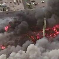 Photo - This image from aerial video shows a raging fire in Seaside Park, N.J. on Thursday, Sept. 12, 2013. The fire began in a frozen custard stand on the Seaside Park section of the boardwalk and quickly spread north into neighboring Seaside Heights. (AP Photo/ABC)