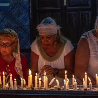 Photo - Jewish pilgrims light candles in the Ghriba synagogue, the oldest Jewish monument built in Africa more than 2,500 years ago, as they  attend the annual Jewish pilgrimage in the resort of Djerba, Tunisia, Friday April 26, 2013. Jews coming from Tunisia, Europe or Israel make their annual pilgrimage to El Ghriba synagogue, commemorating the death of Shimon Bar Yohai, a second-century kabbalistic rabbi who authored a famous religious text known as The Zohar. (AP Photo/Aimen Zine)