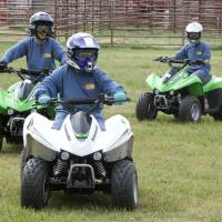Photo - Twelve-year-old Jared Welch maneuvers around cones during a children's ATV safety course at the Logan County Fairgounds in Guthrie, OK, Friday, May 25, 2012,  By Paul Hellstern, The Oklahoman