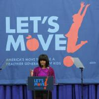 Photo - First lady Michelle Obama greets educators and state and community officials at a