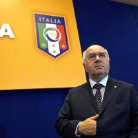 Photo - In this picture taken Friday, July 25, 2014, Carlo Tavecchio attends an assembly of the National Amateur League in Rome. FIFA has asked the Italian football federation to open an investigation into alleged racist comments made by FIGC presidential candidate Carlo Tavecchio.