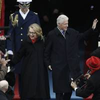 Photo - Secretary of State Hillary Clinton and former President Bill Clinton arrive at the ceremonial swearing-in for President Barack Obama at the U.S. Capitol during the 57th Presidential Inauguration in Washington, Monday, Jan. 21, 2013. (AP Photo/Pablo Martinez Monsivais)