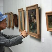 Photo - A visitor inspects Vincent van Gogh's