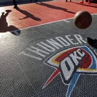 Photo - Thunder fans play basketball in the fanfest area before the start of game two of the Western Conference semifinals between the Memphis Grizzlies and the Oklahoma City Thunder in the NBA basketball playoffs at Oklahoma City Arena in Oklahoma City, Tuesday, May 3, 2011. Photo by Chris Landsberger, The Oklahoman