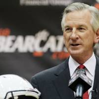 Photo - Tommy Tuberville speaks at a news conference after he was introduced as the new head football coach at the University of Cincinnati, Saturday, Dec. 8, 2012, in Cincinnati. Tuberville had been head coach at Texas Tech, and previously at Auburn and Mississippi. (AP Photo/Al Behrman)