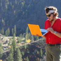 Photo - In this Fall 2013 photo provided by the University of Idaho, University of Wisconsin-Oshkosh student Bobby Theer works on a mountainside in the Frank Church-River of No Return Wilderness in Idaho. Theer is one of the university's first Semester in the Wild Class students. (AP Photo/University of Idaho)
