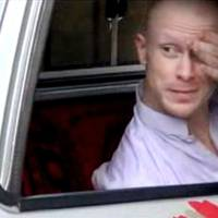 Photo - FILE - In this file image taken from video obtained from Voice Of Jihad Website, which has been authenticated based on its contents and other AP reporting, Sgt. Bowe Bergdahl, sits in a vehicle guarded by the Taliban in eastern Afghanistan. Bergdahl was freed by the Taliban on May 31, 2014, in exchange for five Afghan detainees held in the U.S. prison at Guantanamo Bay, Cuba. Two American values, never leave a man behind and never negotiate with terrorists, collided in the Bergdahl calamity with each ethos running deep in the American conscience. (AP Photo/Voice Of Jihad Website via AP video, File)
