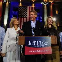 Photo -   U.S. Senate candidate Jeff Flake and his family greet supporters during a campaign stop ahead of the election at the Yavapai County Courthouse Plaza Monday, Nov. 5, 2012, in Prescott, Ariz. The stop on the courthouse steps has been a tradition of Republicans since 1964 when Barry Goldwater concluded his presidential campaign there. (AP Photo/The Daily Courier, Les Stukenberg) MANDATORY CREDIT