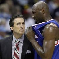 Photo - Los Angeles Clippers' Lamar Odom, right, talks to Los Angeles Clippers coach Vinny Del Negro, during the first half of Game 6 in a first-round NBA basketball playoff series in Memphis, Tenn., Friday, May 3, 2013. (AP Photo/Danny Johnston)
