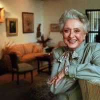 Photo -   FILE- In this March 12, 1997, file photo, actress Celeste Holm poses at a friends' home in Santa Monica, Calif. Celeste Holm, a versatile, bright-eyed blonde who soared to Broadway fame in