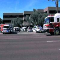 Photo - This frame grab provided by abc15.com shows the scene at a Phoenix office complex where police say a gunman shot at least three people on Wednesday, Jan. 30, 2013. Officer James Holmes said the victims were taken to hospitals and did not know if their injuries were life threatening. (AP Photo/abc15.com) MANDATORY CREDIT  ORG XMIT: NY121