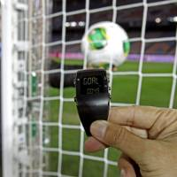 Photo - FILE - In this Wednesday, Dec. 5, 2012, file photo, the goal-line monitoring device is demonstrated before the media at Yokohama Stadium in Yokohama, near Tokyo. For the first time at a World Cup, technology will be used to determine whether a ball crosses the goal line during matches at the upcoming tournament in Brazil. With vanishing spray also being used to prevent encroachment by defenders making up a wall during free kicks, officials at the highest level of the world's most popular sport are finally getting some assistance. (AP Photo/Shuji Kajiyama, File)