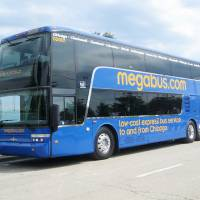 Photo - Megabus.com uses 81-seat, double-decker coaches, said Dale Moser, president and chief operating officer. Photo provided by Megabus.com