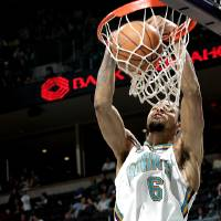 Photo - New Orleans/Oklahoma City Hornets' Tyson Chandler dunks over Utah's Paul Millsap during their NBA basketball game at the Ford Center in Oklahoma City on Sunday, March 4, 2007. The Jazz beat the Hornets 108-94. By John Clanton, The Oklahoman ORG XMIT: KOD