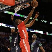 Photo - West Team's Kevin Durant, of the Oklahoma City Thunder (35) goes to the hoop against Team east during the NBA All Star basketball game, Sunday, Feb. 16, 2014, in New Orleans. (AP Photo/Gerald Herbert)