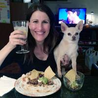 Photo - In this May 5, 2014 photo provided by Dana Humphrey, Joanie Pelzer poses with her dog Hubbell, a 9-year-old Chihuahua, in New York. When Pelzer signed up with a dog-friendly online dating service a few years ago, she was honest about her Chihuahua: He likes people more than other dogs, craves attention, steals food and can't stand to ride in the backseat of a car. Even with a man who loved animals as much as she did, he couldn't keep up with her dog's quirks. On their first date, Hubbell stole the man's breakfast as they drove from New York City to Long Island. They only had one more date. (AP Photo/Dana Humphrey)