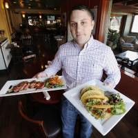 Photo - Shaun Fiaccone is owner of Picasso Cafe in the Paseo Arts District in Oklahoma City. Photo by Paul Hellstern, The Oklahoman  PAUL HELLSTERN - Oklahoman