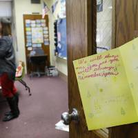 Photo - A hand-written note  from one of her students is taped to Gastineau's classroom door. Dee Ann Gastineau, a Fairview Elementary teacher who inspired a troubled student 30 years ago, is retiring, bringing to an end her 35-year career educating fifth grade students. Her entire career was spent at the same school, Fairview Elementary, 2431 SW 89th Street in Oklahoma City. Photo by Jim Beckel, The Oklahoman