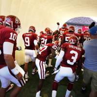 Photo - Oklahoma's Blake Bell (10) and Trevor Knight (9) enter the field through an inflated tunnel for the college football game where the University of Oklahoma Sooners (OU) play the University of Louisiana Monroe Warhawks at Gaylord Family-Oklahoma Memorial Stadium in Norman, Okla., on Saturday, Aug. 31, 2013. Photo by Steve Sisney, The Oklahoman