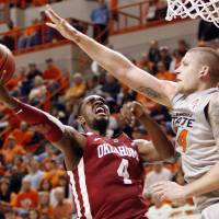 Photo - OU's Andrew Fitzgerald (4) tries to get a shot past OSU's Philip Jurick (44) in the first half during the Bedlam men's college basketball game between the Oklahoma State University Cowboys and the University of Oklahoma Sooners at Gallagher-Iba Arena in Stillwater, Okla., Monday, Jan. 9, 2012. Photo by Nate Billings, The Oklahoman