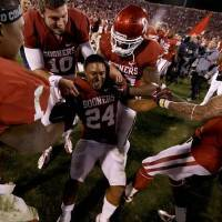 Photo -  Oklahoma's Brennan Clay (24) celebrates after the Bedlam game at Gaylord Family-Oklahoma Memorial Stadium in Norman, Okla., Saturday, Nov. 24, 2012. Oklahoma won 51-48. Photo by Bryan Terry, The Oklahoman
