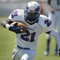Photo - Millwood's Janari Glover (21) runs th ball during a high school football game between Douglass and Millwood in Oklahoma City, Saturday, Sept. 8, 2012.  Photo by Garett Fisbeck, The Oklahoman