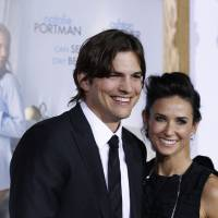 Photo - FILE - In this Jan. 11, 2011 file photo, cast member Ashton Kutcher, left, and Demi Moore arrive at the premiere